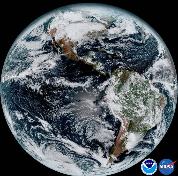 The so-called full disk image shows North America and South America and the surrounding oceans with swirling white clouds overhead.