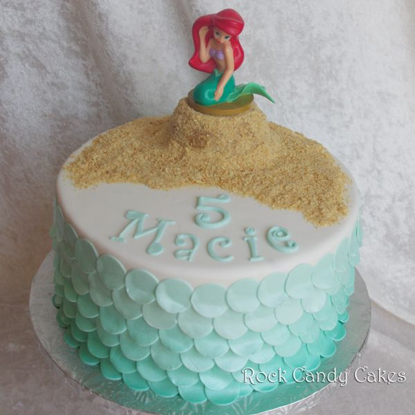 Ariel Mermaid Cake - Fondant ombre scales. Gram Cracker sand...I like the overall idea, but this one just doesn't look finished to me.