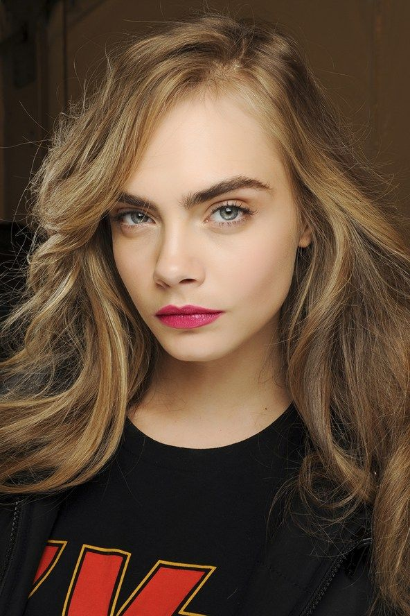 Diane von Furstenberg  Seventies-style waves were the perfect complement to matte magenta lips.