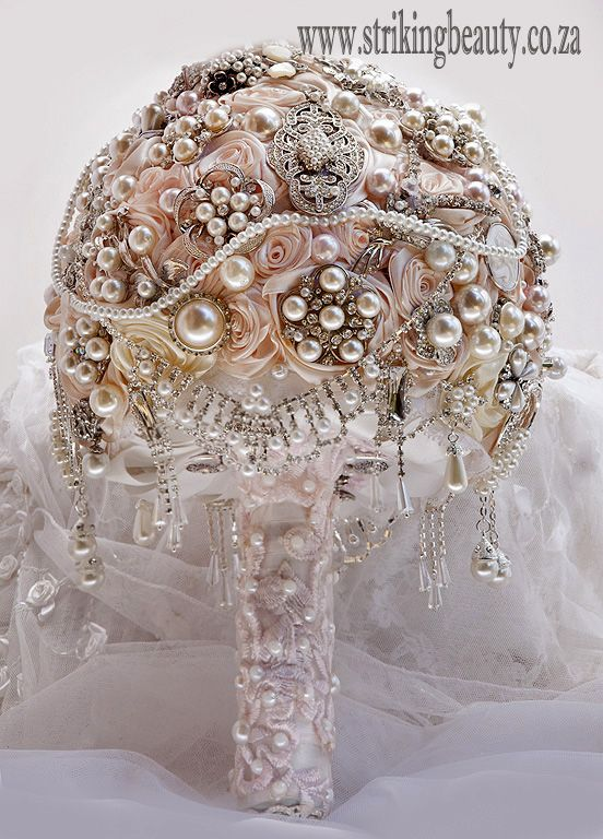 Blush pink brooch bouquet with loads of jewellery and trailing items - hand made flowers and beautiful detail.