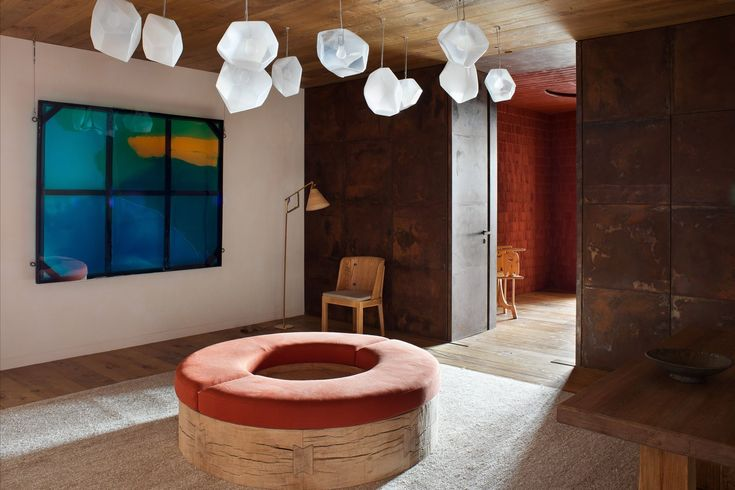 Hand-blown Salt Crystal lights by Jeff Zimmerman hang above custom oak bench in the entrance hall. Tagged: Hallway and Light Hardwood Floor.  Photo 1 of 15 in A Gorgeous Chalet in the Swiss Alps Perfectly Blends Modern and Rustic Design