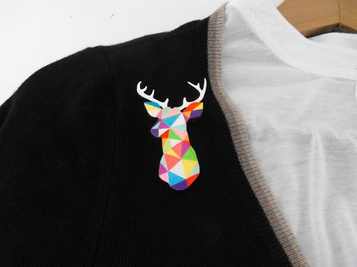 Geometric Deer Brooch Neon 'Stag Head' by Sketch Inc.  This little Harlequin Stag is made from laser cut Baltic Birch wood and hand painted with enamels and acrylic paints and finished with a hard wearing Satin Varnish.