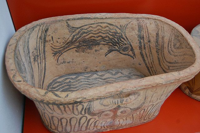Minoan Bathtub with painted fish. Agios Nikolaos Museum Crete.