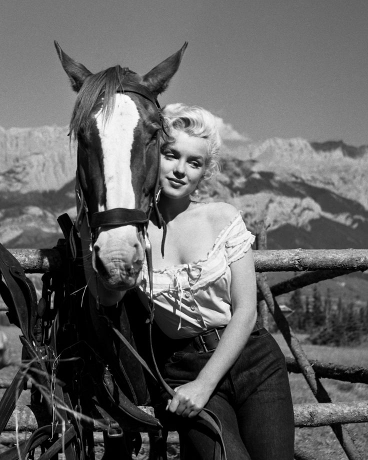 Marilyn Monroe with Horse by Ray O'Neill. Shot during the filming of The River OF No Return.