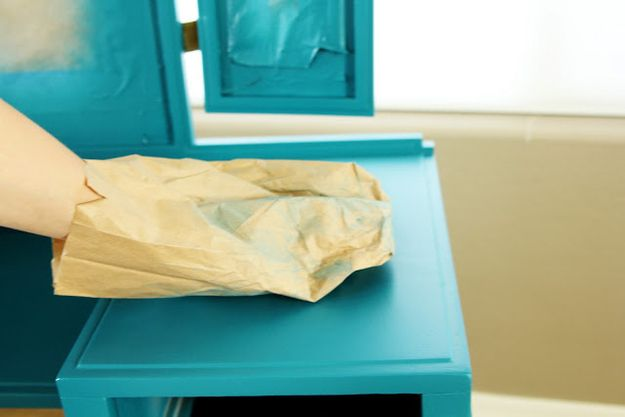Run a brown paper bag over any (dry) painted surface that feels rough.