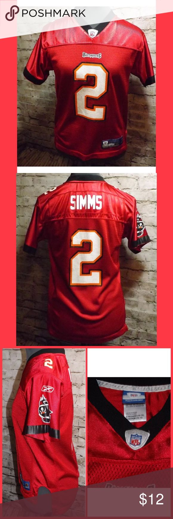 Reebok Buccaneers CHRIS SIMMS NFL Jersey shirt M This is a really nice Reebok Tampa Bay Buccaneers CHRIS SIMMS NFL  Jersey shirt. Size Medium (10/12). The only flaws that I noticed was in some areas around the 2 on front and back are missing some of the black. (Please see photos.) Still in really good condition. Comes from a smoke free home. Reebok Shirts & Tops