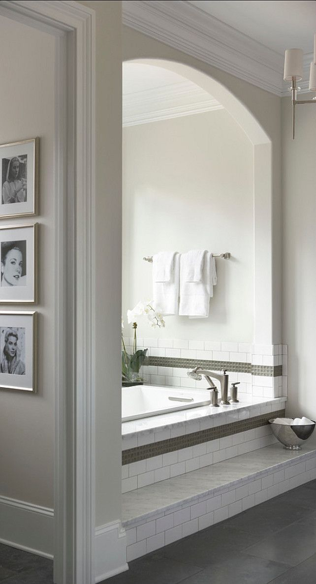 Glazed porcelain tile around tub and limestone floors