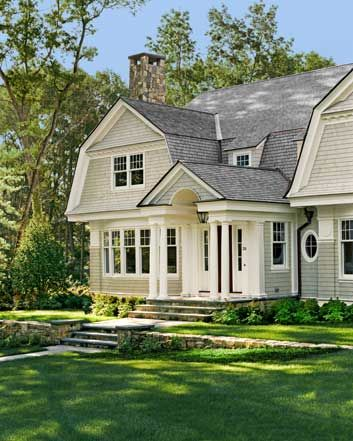 taupe shingle with creamy white trim and copper gutters