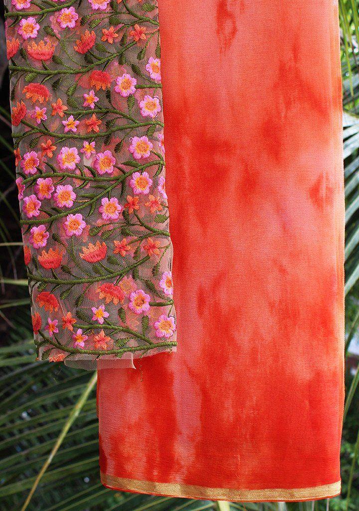Orange chiffon tie-n-dye saree with embroidered blouse piece