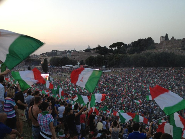 Italian fans gathered in the Circus Maximus in Rome cheer on the national soccer team during the UEFA Euro 2012 championship, by Luke Tyburski (Summer Archaeology Field School 2012).