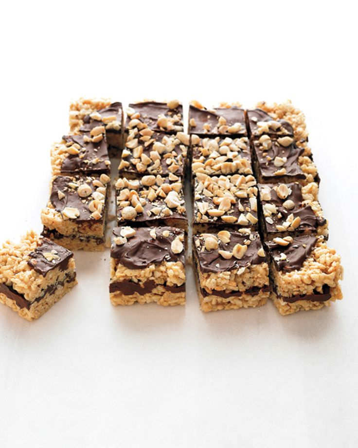 Puffed-Rice Bars with Peanut Butter and Chocolate | Martha Stewart Living - Transform out-of-the-box rice cereal into peanut-packed cookie bars spread with melted chocolate.