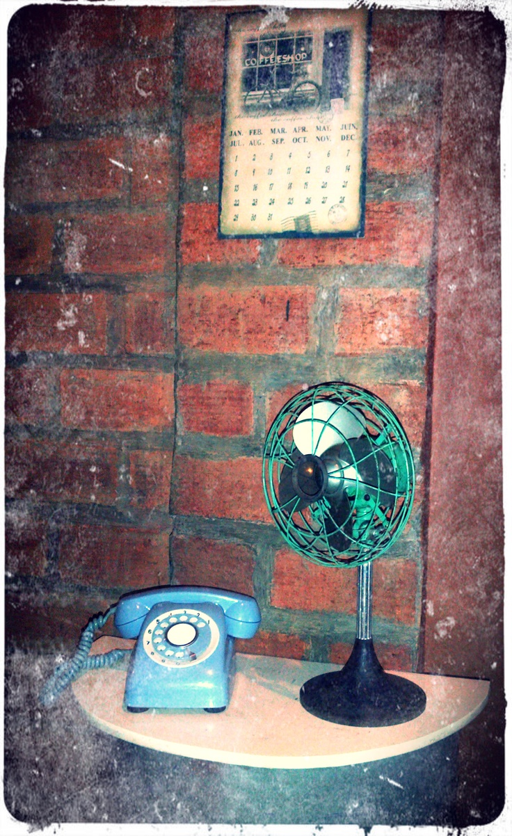 Rotary phone and vintage fan at 1st floor Kedai Kopi Espresso Bar Surabaya.