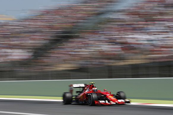 Kimi Raikkonen says he sacrificed his race pace by running an older spec in the Spanish Grand Prix for the good of the Ferrari Formula 1 team. RACER.com