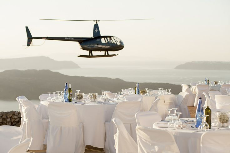 The #helicopter bringing the #bride before the #wedding #ceremony #Santorini. Book now yours at Thermes Villas