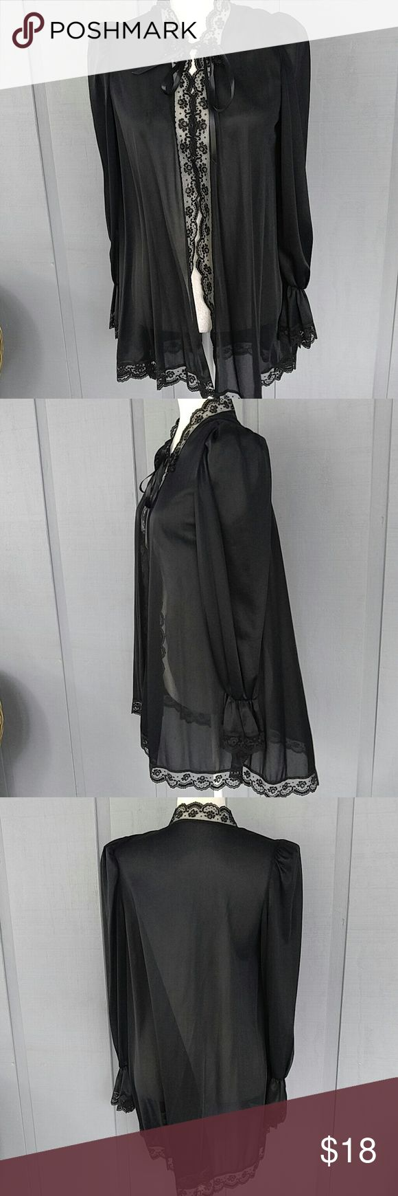 Vintage black short robe by Petra Fashions Short robe that ties with ribbon.  Has beautiful bell sleeves condition is mint Petra Fashions Intimates & Sleepwear Robes