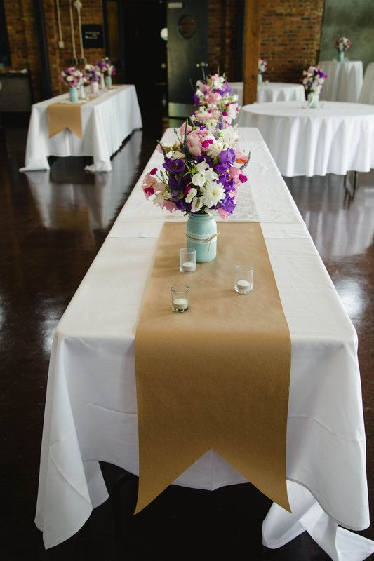 I like these simple parchment/craft paper table runners, easy and can be scribbled on by guests for fun!