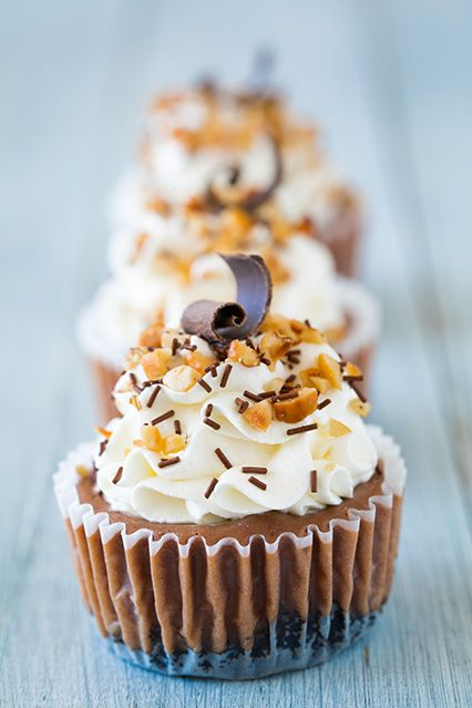 Nutella Cheesecake Cupcakes - these are one of my new favorite cheesecakes! Creamy and rich Nutella cheesecake topped with sweet whipped cream, hazelnuts and chocolate sprinkles. Trust me they are amazing!