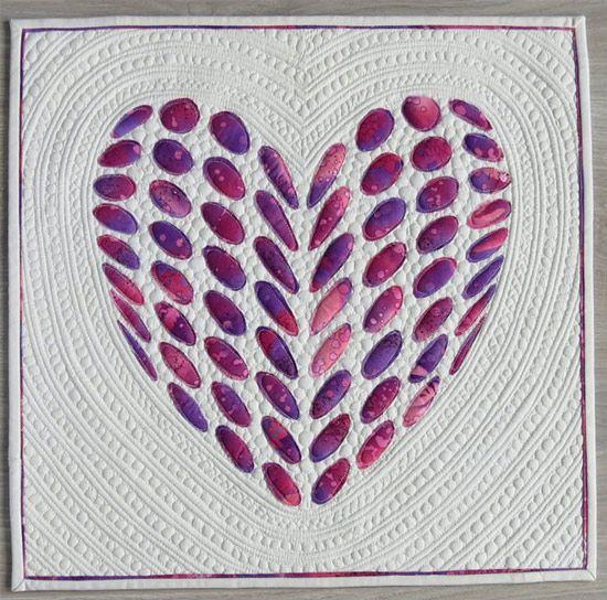 Applique heart quilt patterns- multiple designs available.