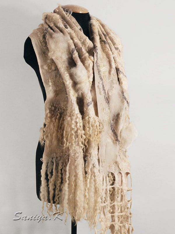 """Fashion Wrap """"Beige"""" felted handmade by SaniyaK on Etsy. The fashion felted wrap is made on the thinnest natural silk of soft Merino wool (18 micron). Luxury textured surface, hand-spun art-yarns, textured woolen yarns, fiber ramii, curls of British sheep breeds and Venslideyl Masham, Alpaca (no one lamb is not suffered because used only sheared wool). Very subtle shades of beige. Hand painting of dyes manufactured England. Warm and cozy. Perfectly complement the image in the boho style..."""