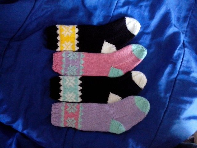 Different versions of our snowflake stocking.