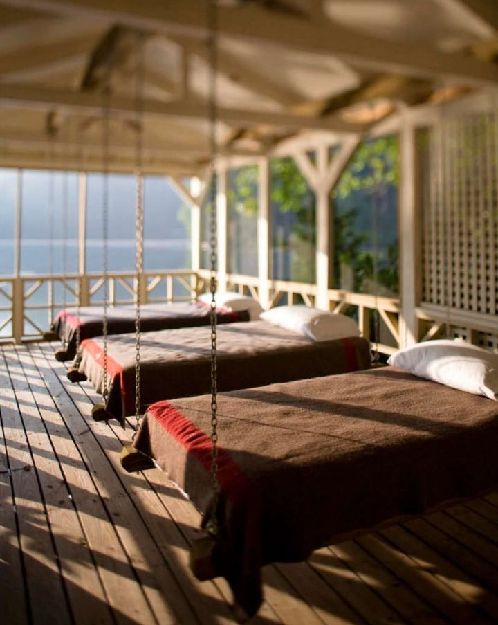Hanging beds on a lake house sleeping porch. Craig Kettles.