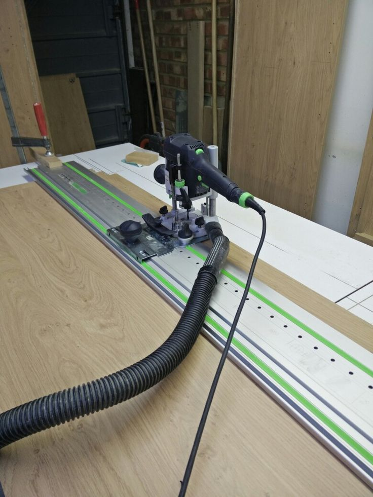 Drilling the side panels ready to take hinge plates and shelf fittings made easy with the LR system from Festool.