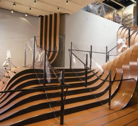 """Stairs at the Longchamp Store NY   Constructed in 1¼"""" hot-rolled steel and taking six months to be built, the stair landscape weighs 55 tons and is an installation of ribbon-like forms that divide and converge to form a topography of walkways, landings and steps."""