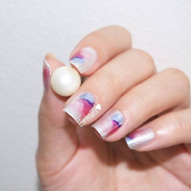 "Happy #manimonday! Blogger @erinzi wears ""Bliss"" nail art, a shimmery, serene blue and pink watercolor design. #incoco #watercolornails #nailart #springnails #dailynailartpics #thenailartstory #nailwrap #nailsofday"