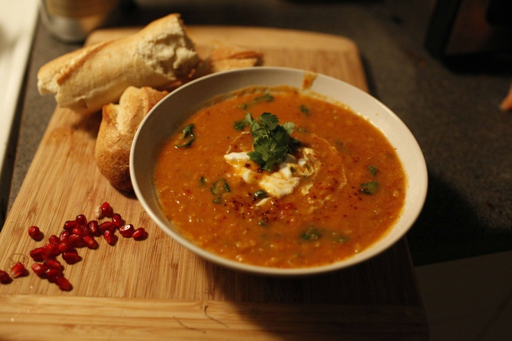 Spiced Red Lentil Soup with yogurt, cilantro, and pomegranates