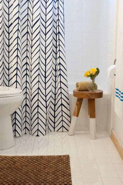 Our Navy Feather Shower Curtain Brings A Pop Of Pattern To The Bath.  #serenaandlily