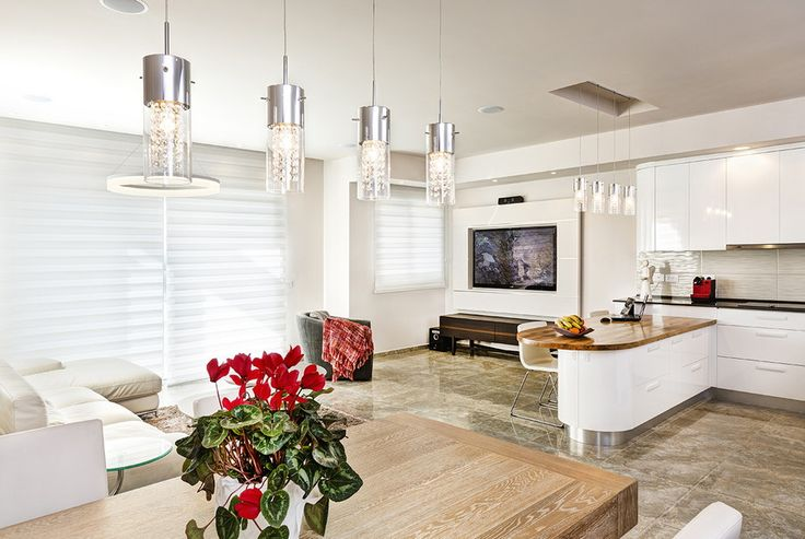 Open-plan living area - make an elegant flow with small details and colors to connect the different areas