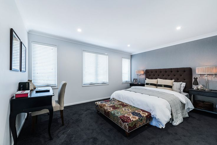 #Bedroom #design #ideas from #Ausbuild's  Ellision #display #home. www.ausbuild.com.au. This #master #bedroom #features an impressive #walk-in #robe and #en-suite with a stunning grey  feature #wall. Decorated with #vintage inspired #lamps and a a multi-tonal bedroom bench.