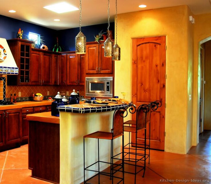 A Bold U0026 Spicy Mexican Kitchen With Golden Adobe Walls, Rich Wood Cabinets,  Blue Accents, A Combination Of Tile And Concrete Countertops, ...