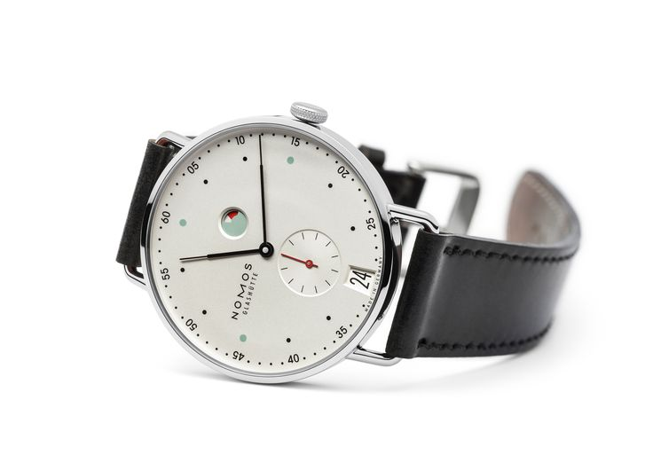 A symphony of a city in white, mint, and red: Designed by the renowned Berlin designer Mark Braun, the Metro model is young and sophisticated, straightforward and slim. The clear minute indexes, hands as fine as quill tips, and a slim case makes this watch flattering to the wrist, the arm, and the eyes.