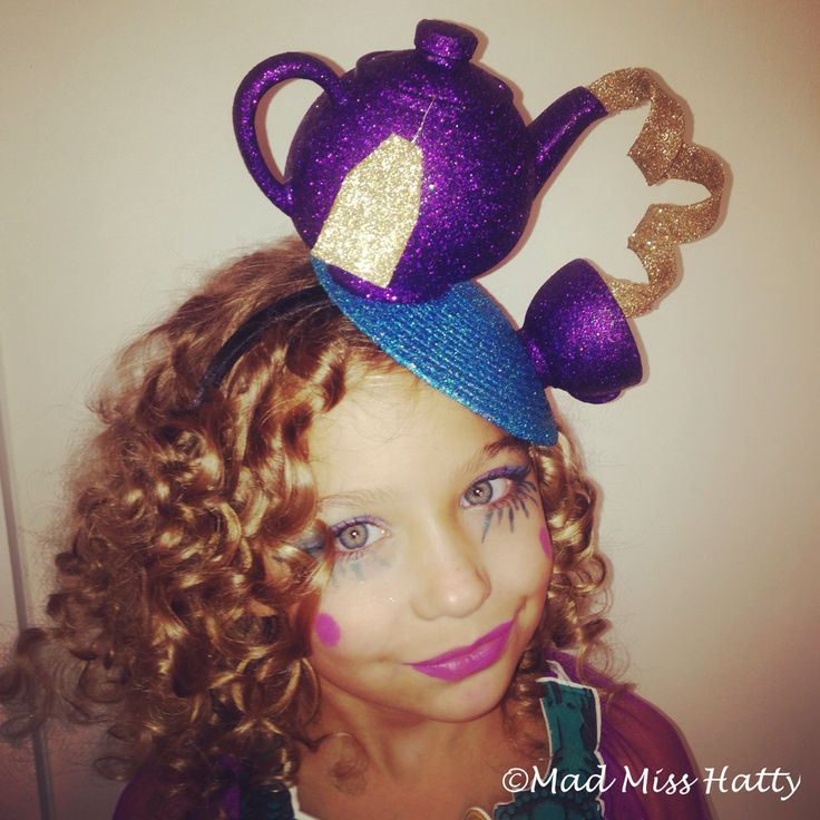 Mad Miss Hatty creation....a Teapot fascinator, glittered for amazing sparkle! I made this to match the Ever After High Madeline Hatter costume for a gorgeous little lady.
