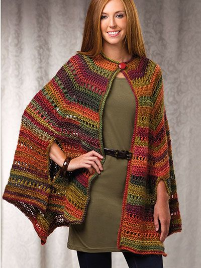 Paris in the Fall Cape.  Light and comfortable but warm enough to ward off the autumn chill, this pretty cape is versatile enough to wear during the day or for an evening out. Design is made using 4 balls of Red Heart Boutique Unforgettable worsted-weight yarn. One size fits most.