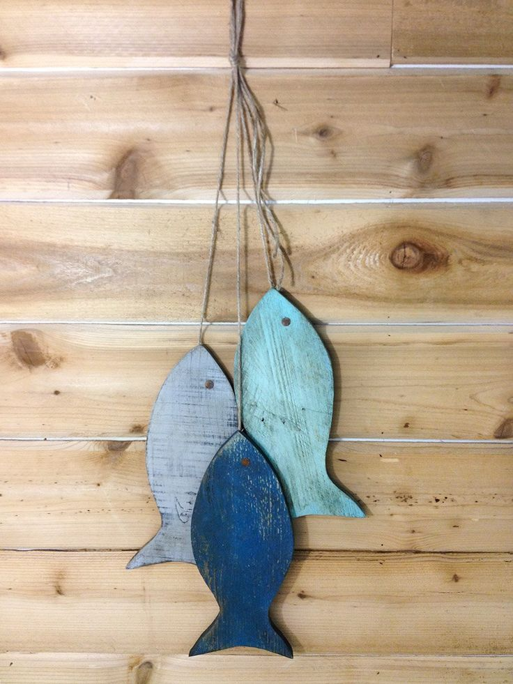 """Lake House Decor, Fishing Decorations for Home, Painted String of Fish Wall decor made with pallet wood - 10"""" wood fish beach blues - beach house decor. This whimsical painted fish decor is a set of three colors made from fence wood. They simulate a great day's catch, hanging with jute string. The colors for this listing are Louis Blur, Provence, and Napoleon Blue. Each wood fish wall art piece measures about 10"""" from top to bottom. The painting was done with chalk paint colors. After the..."""