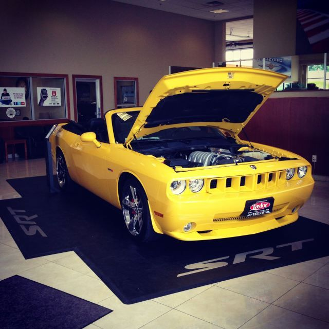 Custom 2010 Dodge Challenger SRT8 Convertible. With a Vortec Supercharger, you'll have a hard time not being a leadfoot!