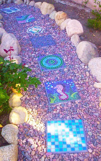 Mosaic Stepping Stone Pathway. Like the colored rocks against the blue stepping stones
