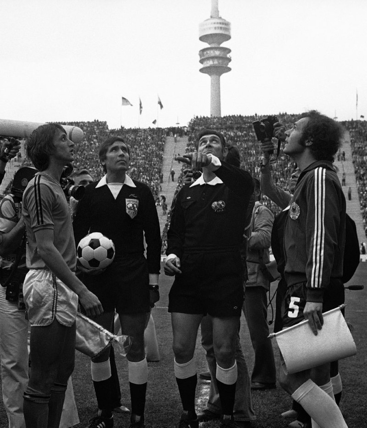 Holland captain Johan Cruyff watches the coin toss together with West Germany's captain Franz Beckenbauer before the start of the 1974 World Cup Final in Munich