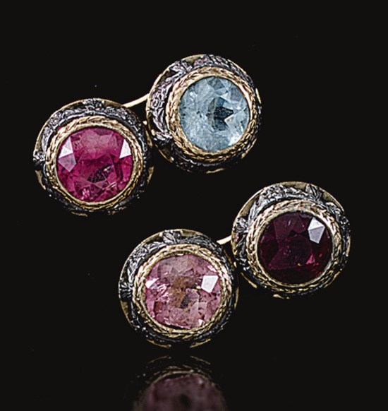 SET OF FOUR TOURMALINE AND AQUAMARINE DRESS BUTTONS, EARLY 20TH CENTURY.  Comprising; three buttons set with circular-cut pink tourmalines and one set with a circular-cut aquamarine, each within foliate garland borders, accompanied by a pair of cufflink connecting bars,  Russian assay marks, accompanied by a case from Fabergé, St Petersburg, Moscow.