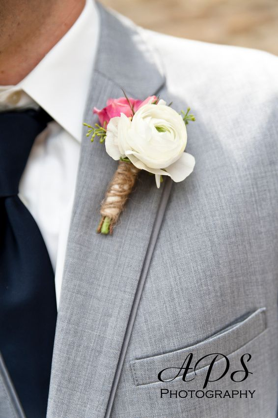Light grey suit and a twine wrapped boutineer.  A very stylish look to say the least!