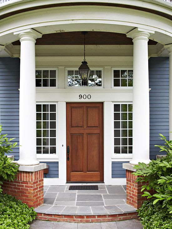 I can't wait to create a springy front door! Love this dark stained door flanked with full length windows. Full length windows define an open entryway and bring natural light into your home.