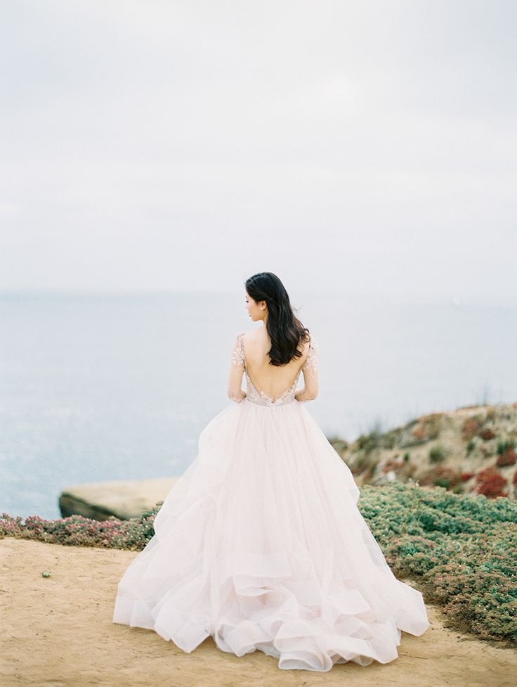 stunning wedding gown with open back and full flowing skirt | Photography: Sally Pinera