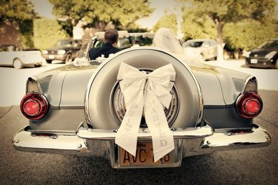 "classic... maybe a few tin cans tied on to pull behind and a little ""just married"" sign :) so cute..."