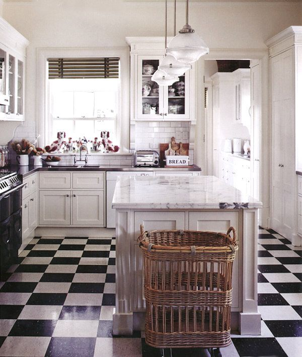 Dark marble (soapstone?) and carrera counters with black and white floors.    5+by+sharyn+cairns-country+style-dustjacket+attic.jpg (600×709)