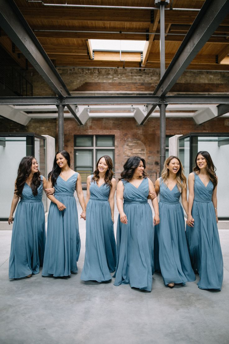 These bridesmaids look flawless in slate blue bridesmaid dresses. | Whims and Joy Photography