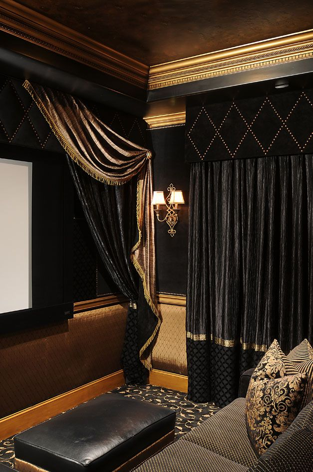 Dark and dramatic in the media room. Love the drape detail, rug etc.