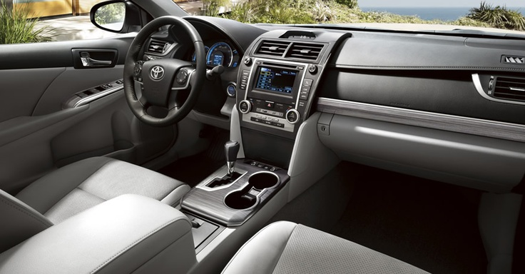 The 2012 Toyota Camry Hybrid XLE interior shown in available Ash Ultrasuede® with Display Audio with Navigation and Entune™   http://sunshinetoyota.ca