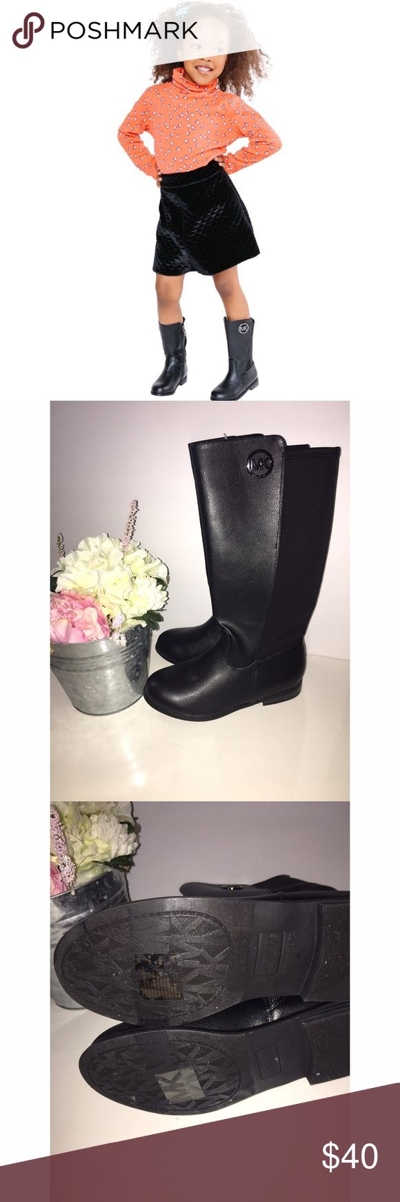 "Michael Kors Girls' Boots Emma Lily Brand New Never Worn ❗️  Michael Kors Girls' Boots Emma Lily  Your little diva need these MK boots to match mama's fly 😍  Sleek and Smooth riding boots. Subtle detail with MK round ornament.   Black  Round toe   Approx. 12"" shaft height  Approx. 1"" heel  Leg Circumference approx: 12"" Side zipper closure  Rubber sole   Original box not available  Photo Cred: Kidsshoes.com  Make me an offer 😉 Michael Kors Shoes Boots"